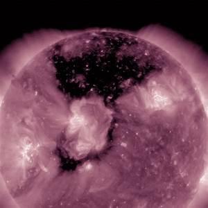NASA spots MASSIVE black coronal hole on the sun from ...