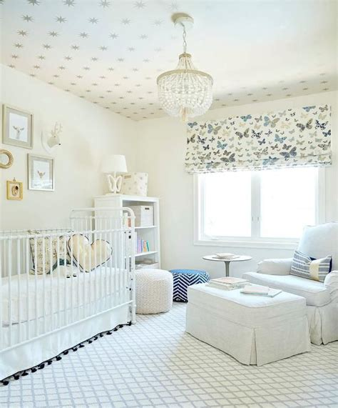 neutral gender nursery features  ceiling clad  gold
