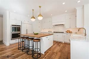 White kitchen island with butcher block transitional for Best brand of paint for kitchen cabinets with wall art iron work