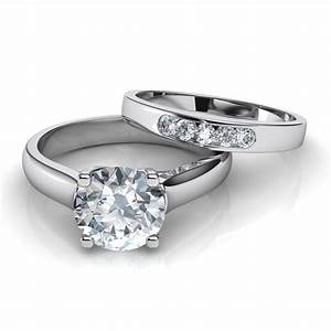 Cross prong solitaire engagement ring and wedding band for Wedding and engagement ring set