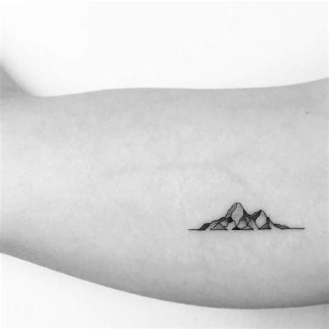 mountain tattoos on the right inner arm artist ok