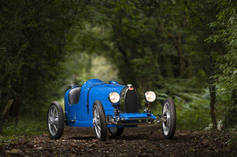 • a recreation of their classic, bugatti engineers used the latest in ev technoology to offer a top in order to appeal to their youngest drivers, the baby bugatti ii has a slow key and the speed key. Bugatti Baby II Unveiled at 110th Anniversary