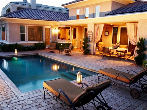 Mediterranean Stone Patio With Luxurious Swimming Pool And