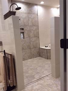 walk in shower and tub area no door to clean loving it With walk in shower no door