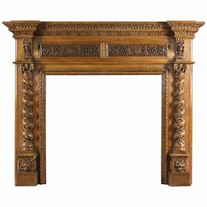 A Large Antique French Fireplace Mantel In Portoro Marble