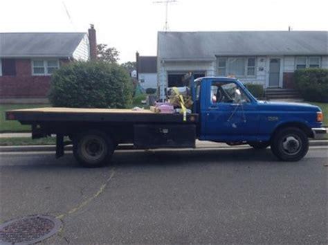 buy   ford  flatbed pick  diesel dually