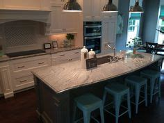 this silver cloud granite with white cabinets and