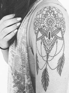 Tattoo of a dream catcher, mandala, lotus flower mashup. Ink by Christina Fleming, montreal