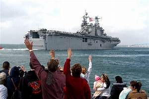 File:US Navy 060215-N-6843I-318 Family and friends wave ...