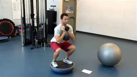 squat bosu hold goblet pulses db