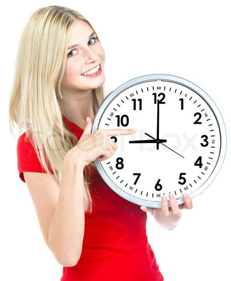 Young woman holding a clock time management concept nine o`clock | Stock Photo | Colourbox
