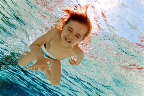 girl smiles swimming  water   pool stock