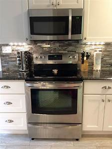 My beautiful kitchen renovation with allen roth shimmering for Kitchen cabinets lowes with art glass wall sconces