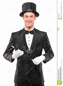 A Magician Holding A Magic Wand And Posing Stock Image ...