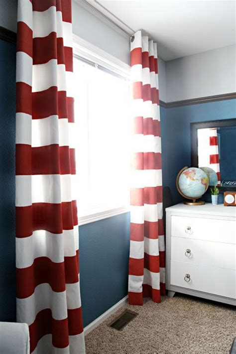 navy walls with stripe curtains baby boy s room