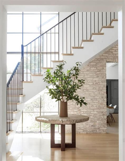 table stairs minimalist foyer with round concrete table under staircase transitional entrance foyer