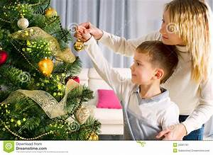 Kids Decorating A Christmas Tree Stock Image - Image: 22081787