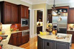 cozy kitchen featuring mixture of wood tones from light With what kind of paint to use on kitchen cabinets for wrought iron candle holders wall