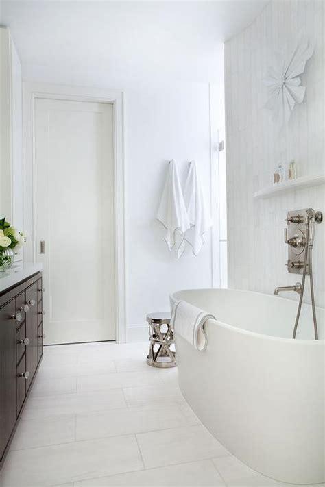 white master bathroom  brown washstand transitional