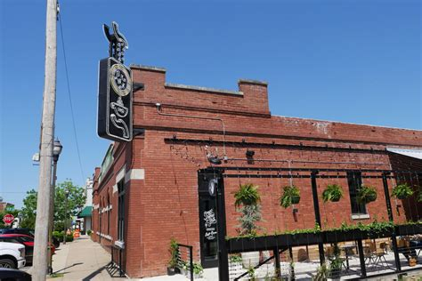 Exterior signage for onyx coffee lab is up at the 1907 on east walnut street in downtown rogers. The 1907: Inside Onyx Coffee Lab's Stunning, Soaring New Arkansas HQ