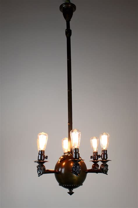 arts and crafts rare monk face fixture with six lights