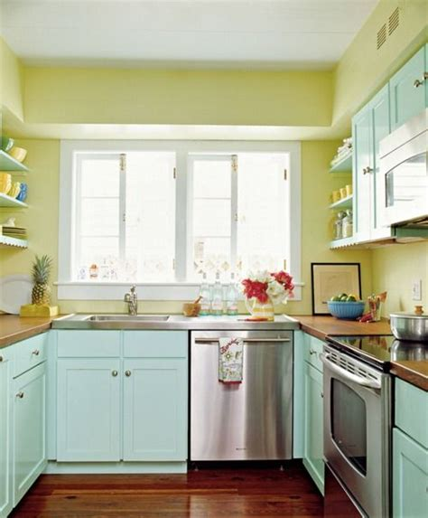 yellow and teal kitchen with bright blue and orange or