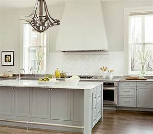 Gray kitchen features gray cabinets paired with white and