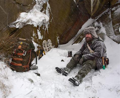 bushcraft winter snow boots survival hobo stove wilderness freezing water ravenlore wild bug survive frozen melting keeping warm feet