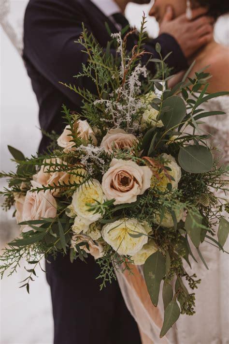 fresh pine rustic getaway winter wedding white rose