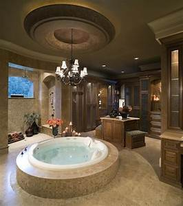 8 luxury master bathrooms every couple dreams of for Putting a tv in the bathroom