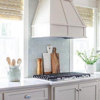 light blue kitchen backsplash blue kitchen island with wood and iron barstools transitional kitchen