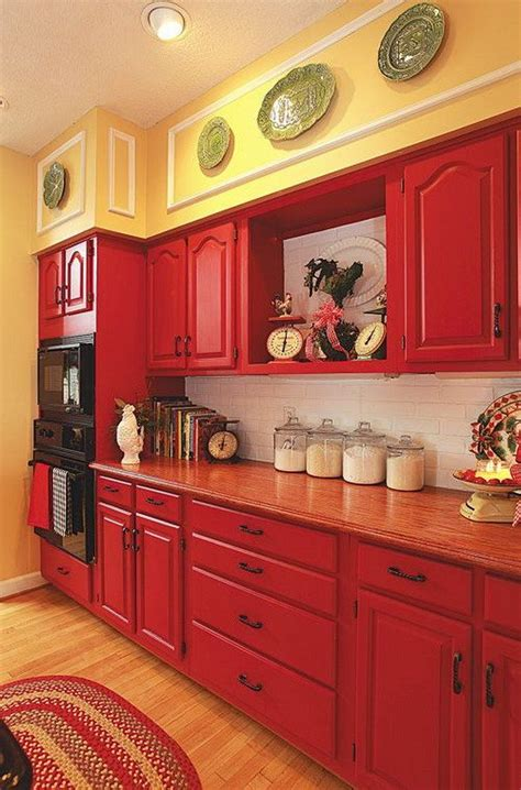 red cabinets paired  pale yellow walls  white subway tile backspalsh red kitchen