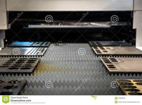 laser cutter cutting metal plates stock  image