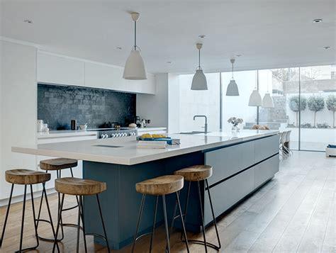 bold blue white linear basement kitchen