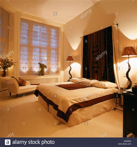 Fabric Hanging Headboard Above Divan In Bedroom With