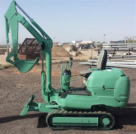 komatsu pc  mini excavator diesel powered rubber tracks backfill dozer blade