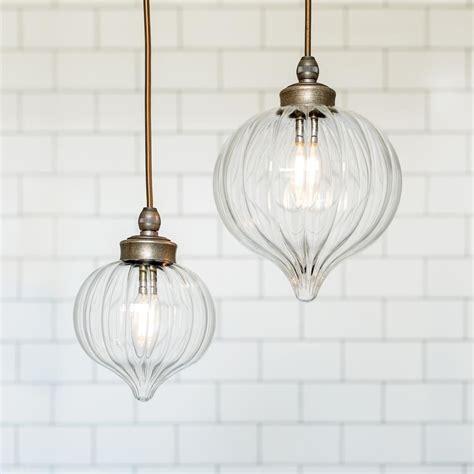 Hanging Bathroom Light Fixtures by Bathroom Pendant Light In Antiqued Brass Lighting In