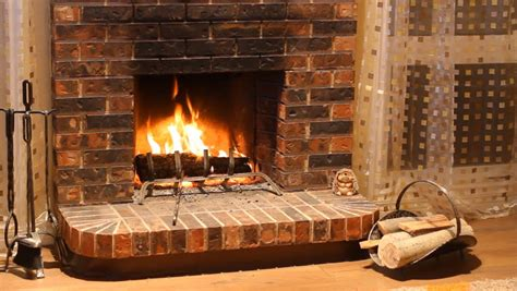 Man Positions Logs In Burning Fireplace 1080p Stock