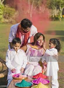 family celebrating holi with colors stock photo getty images