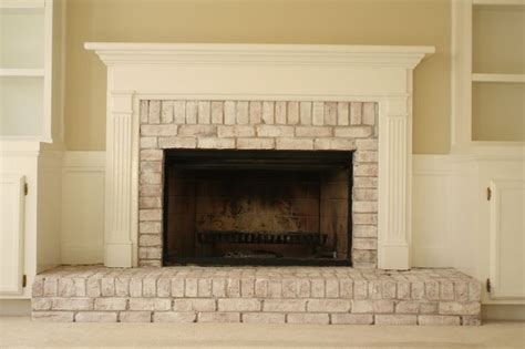 whitewash fireplace whitewashed brick fireplace a simple mix of latex paint about 1 2 water 1 2 paint maybe more