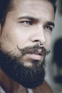 Picture Of A Nose Septum Piercing With A Hoop Plus A Super