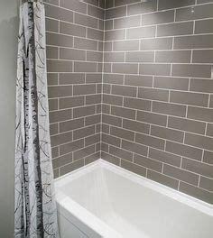subway tiled master shower  accent strip design