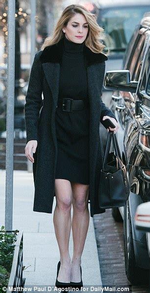 Hope Hicks bundles up in black but bares her legs for ...