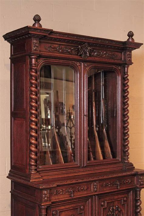 Gun Cabinets For Sale by 19th Century Carved Oak Eight Gun Display Cabinet