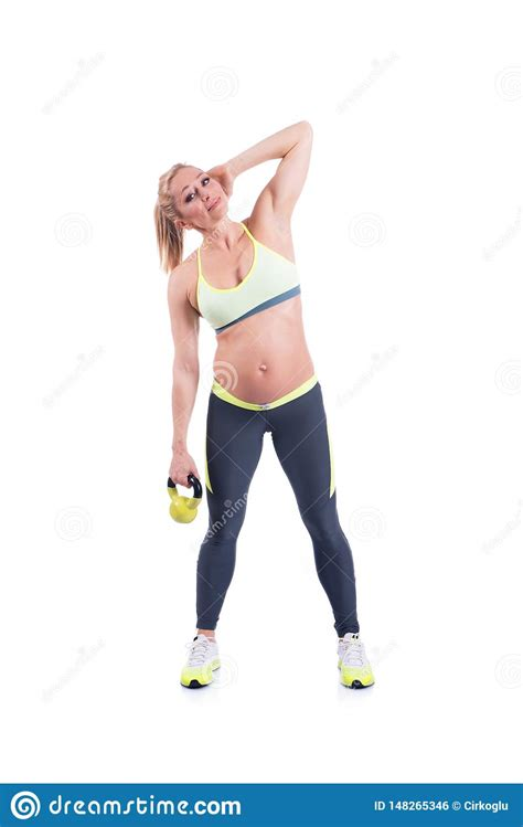 kettlebell pregnant doing happy exercise belly