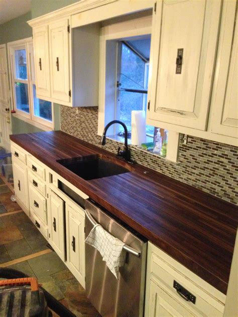 butcher block counter top brick built a pair of black walnut butcher block countertops to replace the awful laminate in the