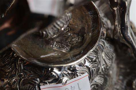 cesti di fiori figure virili con cesti di fiori argento sbalzato