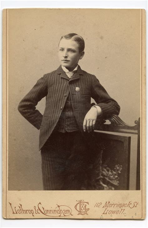 photograph  young man wearing badge  lowell