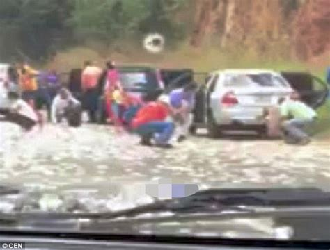Looters In Venezuela Filmed Stealing From Car Crash Victim