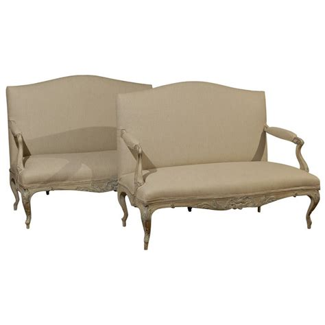 Upholstered Settees by Two Louis Xv Style Painted Wood Upholstered Settees
